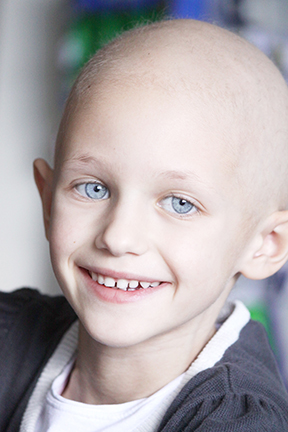 smiling child with cancer