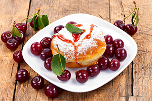 Donut with jam and fruits